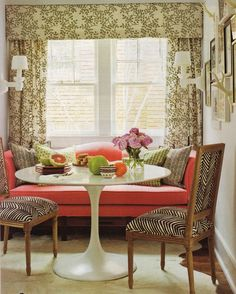 Love the idea of using a sofa in a dining area!