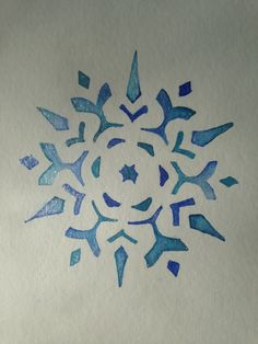 Watercolour snowflake with irridescent wash.