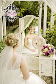 Bridal portrait under majesty canopy with white shabby chic antique vanity. Classic Fall Wedding.  Photography:  Andie Freeman Photography www.TheAthensWeddingPhotographer.com  Coordinating:  Wild Flower Event Services Venue:  The Thompson  House and Gardens, Bogart, GA Floral:  Flowers by On