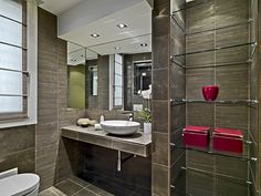 Modern grey spacious half-bath with floor-to-ceiling glass shelving