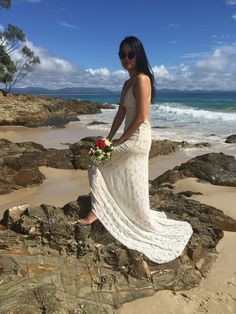 This backless gown, made by Vancouver wedding dress designer Hrissa Soumpassis, is cut from luxurious ivory stretch lace that's perfect for a destination wedding Backless Gown, Stretch Lace, Designer Wedding Dresses, Vancouver, Lace Skirt, Destination Wedding, Gowns, Bridal, Luxury