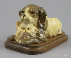 """Статуэтка Джузеппе Армани Dog and Cat ПРОИЗВОДИТЕЛЬ: Florence - Giuseppe Armani (Италия) НАЗВАНИЕ: Dog and Cat НОМЕР: 3563 ГОД: середина 1970-х СОСТОЯНИЕ: Отличное, без повреждений. Без оригинальной коробки. ВЫСОТА: 6 см ШИРИНА: 9 см ГЛУБИНА: 7 см МАРКИРОВКА: Подписана """"G. A."""" и имеет метку Capodimonte - букву N c короной на основании."""