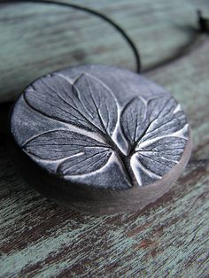 Polymer clay Bleeding heart pendant by Lynn Lunger (UnaOdd)