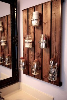 A rustic pallet is the perfect skinny surface on which to hang jars that house makeup tools. Plus, it acts as a design element first, storage second.