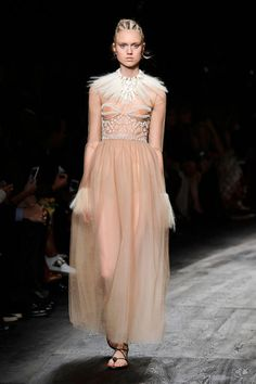 Whoever said romance is dead has not yet perused the latest catwalks. Feathers, ruffles, pastels, cream, chiffon and sheer details add up to the sort of earnestly pretty frocks that make even the most cynical fashion girl swoon.  Pictured: Valentino