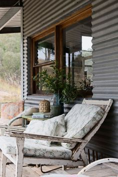 A lovely laid back chair in front on the verandah of a country home. Photograph from Australian Country Style Mag. House Cladding, House Siding, Metal Siding, Metal Cladding, Barn Siding, Timber Windows, Timber Window Frames, Tin House, Decoration Originale
