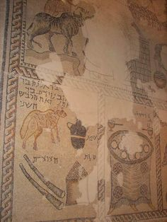 Sepphoris: Synagogue - biblical scenes. On the top side the consecration of Aaron in the Tabernacle (based on Exodus 29), while the bottom of the section are scenes of the daily offering (bottom left) and shewbread table (bottom right).