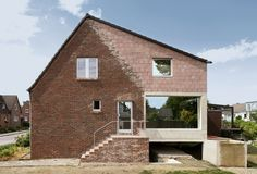 Built by Amunt Architekten Martenson und Nagel Theissen in Aachen, Germany with date Images by Filip Dujardin. This small estate house with a large garden - acquired by the clients in the winter of 2010 - is located on the. Architecture Cool, Concrete Building, Adaptive Reuse, Small Buildings, Brick And Stone, House Extensions, Built Environment, White Houses, My House
