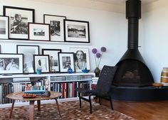 Photo Ledge Ideas Black Chair In Modern Living Room Ideas With Picture Ledge And Brown Area Rug Also Floating Picture Ledge Shelf Ideas Chalet Chic, Picture Ledge, Picture Frames, Picture Walls, Picture Shelves, Photo Walls, House On A Hill, Interior Photography, White Photography