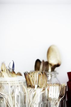 metallic flatware in mason jars