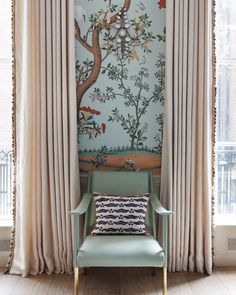 Traditional drawing living room with a Degournay wallpaper panel in pale turquoise. Neutral curtains with a colourful pompom trim to pick up the colours in the wallpaper. Design by Salvesen Graham