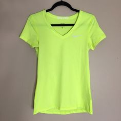 Nike Pro v-neck t-shirt • worn twice Nike Pro v-neck t-shirt in volt. very good condition, aside from a very small stain in the center of the shirt, as pictured. • this t-shirt is great, the material wicks the sweat off your skin ASAP, so it's perfect for working out. • comment with any questions & feel free to make an offer, prices are always negotiable (no lowballing please)! • 15% OFF BUNDLE OF 2 OR MORE‼️ Nike Tops Tees - Short Sleeve