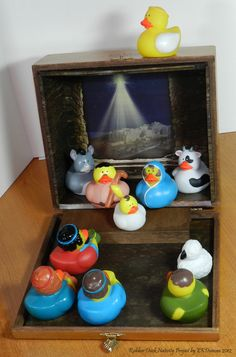 Rubber Duck Nativity - Merry Christmas Fun! A cigar box was decorated to act as scenery and storage for the Nativity Rubber Duck set.  by EKDuncan at http://www.ekduncan.com/2012/12/rubber-duck-nativity-merry-christmas-fun.html#