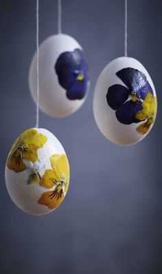 Easter Egg Painting. Dried, flattened flowers, applied to the egg, with mod podge and a paint brush! Let dry and enjoy a Beautiful Decoration,