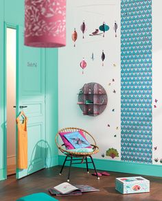 Mobile, shelf, lantern, love the coloured baseboard to match door and single strip of wallpaper