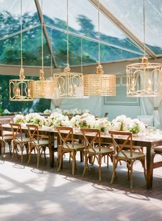 What a cool idea. I believe the lighting steals the show. This would be nice for an outdoor wedding bar. See more on Style Me Pretty. {Images via Corbin Gurkin}