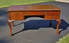 Antique solid wood executive desk with stars engraved on the legs. claw and ball feet