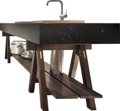Image: Dolmen kitchen in black marble and american walnut by Lando
