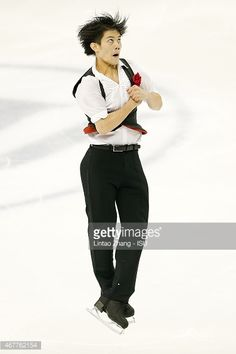Takahiko Kozuka of Japan performs during the Men's Short Program on day three of the 2015 ISU World Figure Skating Championships at Shanghai Oriental Sports Center on March 27, 2015 in Shanghai, China.