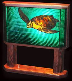 Hawaii's green sea turtles are so beautiful, and this one is captured in its ocean environment. An elegant table lamp.