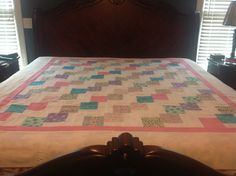 Pink falling charm quilt top.