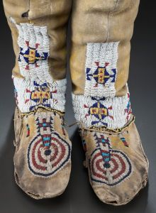 American Indian Art:Beadwork and Quillwork, A PAIR OF CHEYENNE BEADED HIDE HIGHTOP MOCCASINS