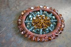 Beaded dorset button. Notice the seed beads are interspersed in the design, not just an edging.