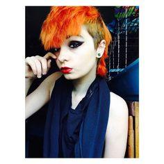 Loving this Unique bright orange shirt hair. Dyed hairstyle. Colored hair. Unique hair. #colour