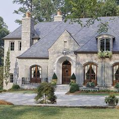 French Country. Arched windows, rock.