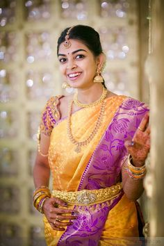 Soft lavender and orange saree. #southindianwedding #southindianbride #weddingjewellery #goldjewellery #nethichutti #oddiyanam #silksaree #orangesaree #contrastcoloursaree Facebook: https://www.facebook.com/Shopzters?ref=bookmarks Website: www.shopzters.com