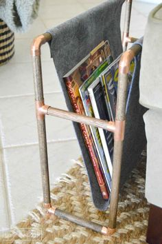 Glue felt around wooden dowels for a cheap and pretty magazine holder.