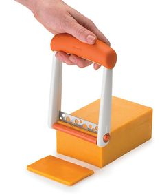 Apricot Orange Slicester One-Handed Cheese Slicer by Chef'n on #zulily today $7.50. {OMG, every cheese slice would be EQUAL. My OCD is in overdrive.}