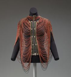 Object Name Bodice Date 20th century Culture African (Dinka peoples) Medium fiber, glass beads, cowrie shell