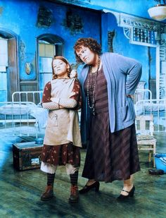 """Alicia Morton as Annie and Kathy Bates as Miss Hannigan in the 1999 Television version of """"Annie""""."""