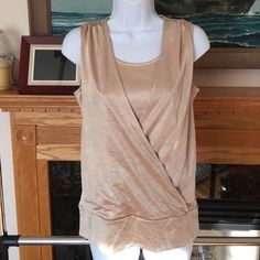 """Chicos Gold Shimmer Sleeveless Top Top in good condition. A few small pulls in front of top. No rips,stains or tears. Smoke free pet friendly home. Offers welcome. No trades or outside posh transactions.                                       100% polyester.                                                    Measured laying flat: bust: 18"""", length: 25"""" Chico's Tops Tank Tops"""