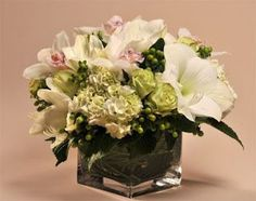 vertical orchid arrangement | white hydrangea, amaryllis, cymbidium orchids, mint green roses and ...