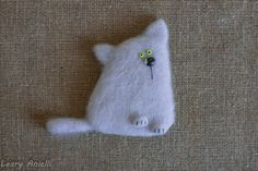 It's a wonderful warm cat, felted from wool. Its nose and eyes are made of backing polymer clay. 100% hand made.  The item is light, that's why