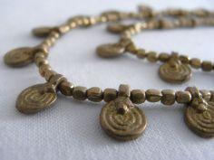 Beautiful detail of the handmade brass spirals.