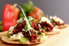 Tostaditas de Chorizo - Grilled Mexican chorizo and fresh guacamole on a savory tortilla crisp.  More: http://www.sohotaco.com/2014/07/14/taco-catering-with-fantastic-appetizers  #tacocatering #ocfoodies