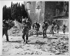 [African American soldiers on patrol near bombed buildings, somewhere in Europe]/ U. NAACP Collection, Prints and Photographs Division, Library of Congress Courtesy of the NAACP Italian Campaign, Pearl Harbor Attack, Challenges And Opportunities, Germany And Italy, Prisoners Of War, American Soldiers, Historical Photos, World War Ii, Memorial Day