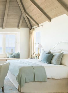 Modern farmhouse style in romantic bedroom with wood ceiling on Hello Lovely Studio