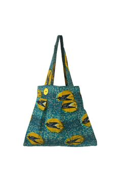 This tote bag has a cool shape and comes in a unique hummingbird African print. Asho Market, around $41.00 U.S.  See more graphic tote bags at  easystyleformoms.com.  #totebags
