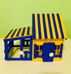 A personal favorite from my Etsy shop https://www.etsy.com/listing/250338344/blue-and-yellow-popsicle-stick-house