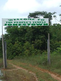 'Welcome to Jonestown'. This sign marks the entrance to the site of one of the worst religious massacres in history perpetrated by Jim Jones in Guyana  (www.stratageodata.com)