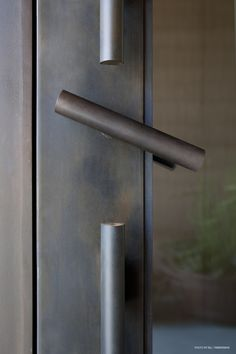 Custom Steel Handle and lockset, DUST architecture in collaboration with Refractory Studio.
