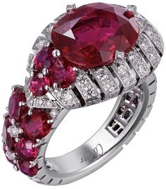"CARTIER. {Close up} ""Garance"" Ring - Platinum, one 6.25-carat oval-shaped Ruby from Mozambique, nine round and oval-shaped Rubies from Burma totalling 2.94 carats, brilliant-cut Diamonds. Étourdissant Cartier 2015 High Jewellery"