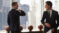 Gabriel Macht as Harvey Specter and Patrick J. Adams as Mike Ross in Suits