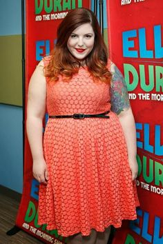 singer mary lambert in coral lace dress