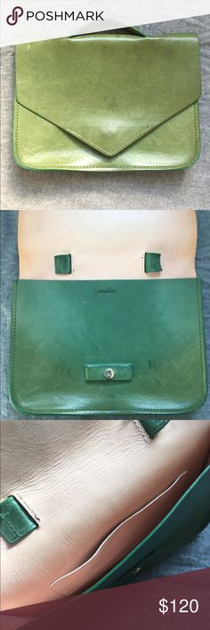 "🎈S A L E🎈Steven Alan  Green leather clutch Visibly used and scratched on exterior but distress adds to character! I purchased 3 years ago at Steven Alan store in NY. Interior leather is in perfect condition. Outside dimensions: 9""h x 12""w. Handle: 5""w, 1"" space to fit fingers. This is a special little bag - the leather color is a gorgeous green, it's an unusual but cool size for a clutch. I got a ton of compliments on it. It also fits an IPAD! Steven Alan Bags Clutches & Wristlets"