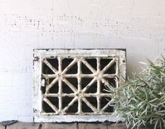 vintage metal heating grate - white chipped paint patina urban farmhouse decor/display. $24.00, via Etsy.